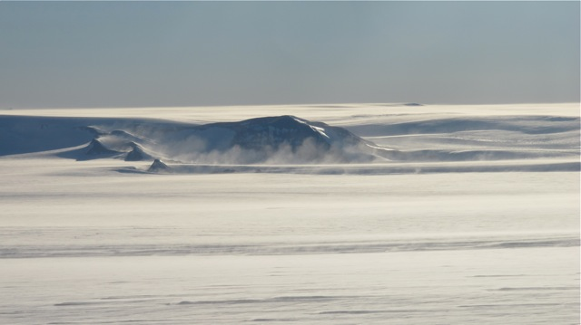 Looking like ocean waves is windblown snow coming off the Pensacola Mountains in Antarctica, as seen from the IceBridge DC-8 on Oct. 15. Credit: NASA / Jim Yungel